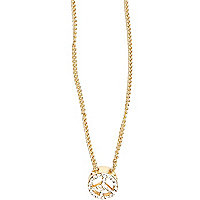 Gold tone diamante encrusted peace necklace