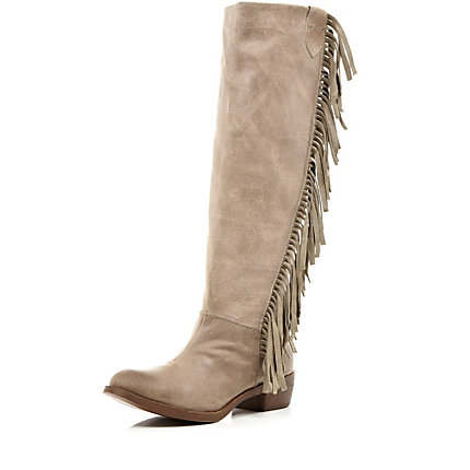 Beige fringed side knee high boots