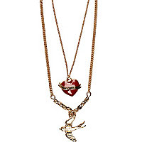 Gold tone swallow and heart pendant necklace