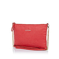 Pink embossed RI logo cross body bag