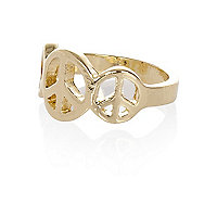 Gold tone triple peace ring