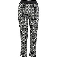 Black geometric print trousers