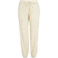 Cream Pacha embellished trousers