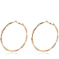 Gold tone twisted hoop earrings