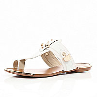 White metal trimmed toe loop sandals