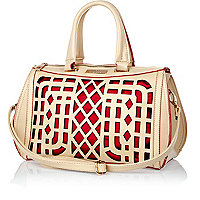 Cream and red laser cut bowler bag