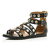 Black studded eyelet gladiator sandals