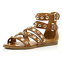 Light brown studded eyelet gladiator sandals