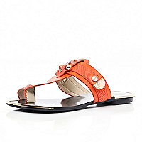 Red metal trimmed toe loop sandals