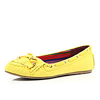 Yellow fringed moccasins
