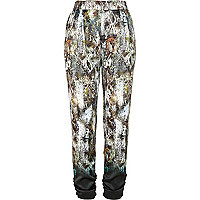 Green snake print dip dye tapered trousers