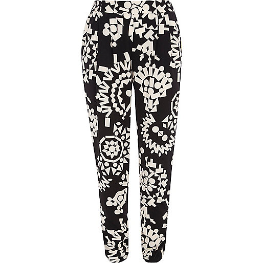 Black and white tribal print tapered trousers