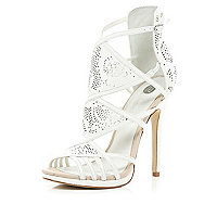 White laser cut high-vamp stiletto sandals