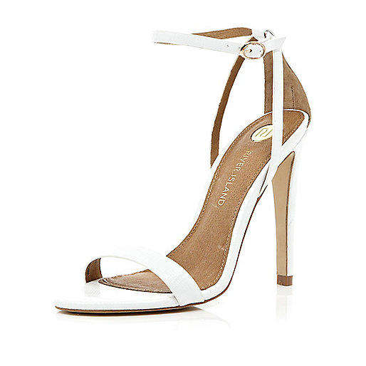 White barely there stiletto sandals