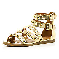 Gold studded eyelet gladiator sandals