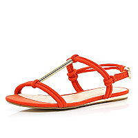 Red metal T bar sandals