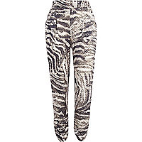 Beige sequin snake print tapered trousers