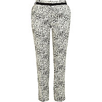 Black and white jacquard print trousers