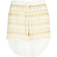 Cream skull lace diamante dip hem shorts