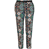 Orange Aztec print trousers