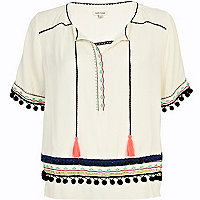 Cream pom pom embellished trim top