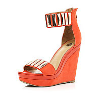 Red metal plate embellished strap wedges