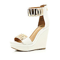 White metal plate embellished strap wedges