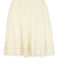 Cream lace trim mini skirt