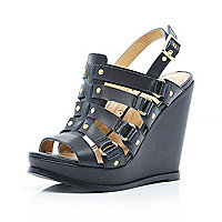 Black caged buckle wedges