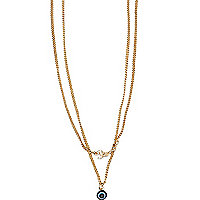 Gold tone double eye and word necklace