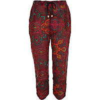 Red abstract print ruched hem trousers