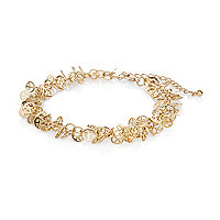 Gold tone peace sign anklet