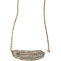 Gold tone feather necklace