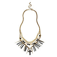 Gold tone skull and spike double necklace