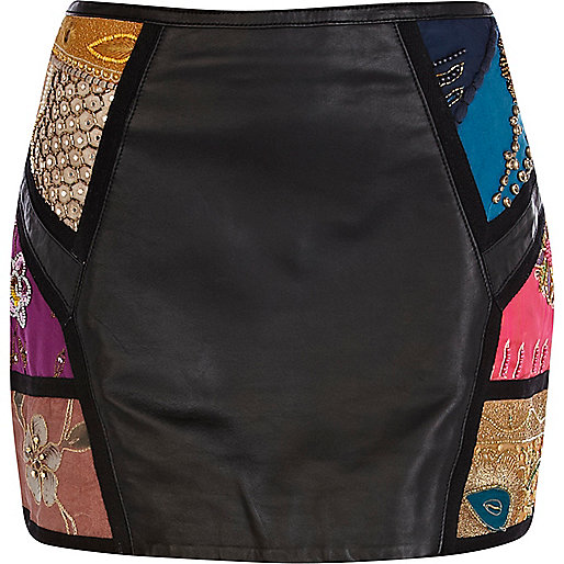 Black leather embellished mini skirt