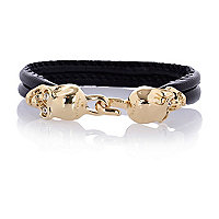 Black leather double skull bracelet