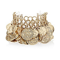 Gold tone layered coin statement bracelet