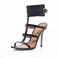 Black cuffed stiletto sandals