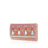 Pink tweed embellished clutch bag.