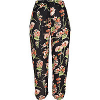 Navy floral print ruched hem trousers