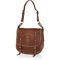 Brown leather studded saddle bag