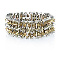 Silver and gold tone spike bracelet