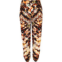 Orange animal print tapered trousers