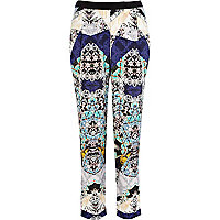 Blue kaleidoscope print smart trousers
