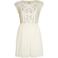 Cream embellished panel skater dress
