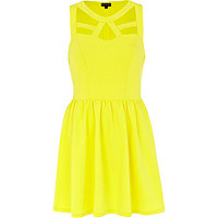 Yellow cut out sleeveless skater dress