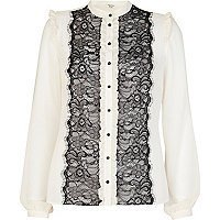 Cream lace front frilly blouse