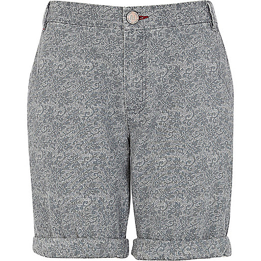 Light blue floral print roll hem shorts