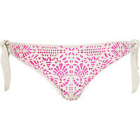 Pink laser cut tie side bikini bottoms