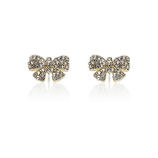Gold tone rhinestone bow stud earrings